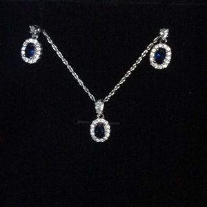 Jewelry - Blue and white diamond necklace and earring set